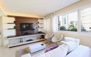 whtie living room with television on wood entertainment stand